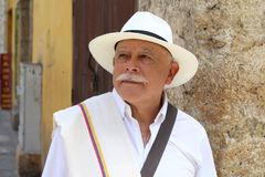 Elderly latino man looking away stock image