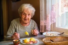 An elderly lone woman portrait dines in his home royalty free stock images