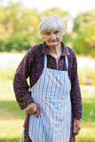 Elderly lonely woman in nature Stock Photos