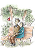 Elderly Love. An elderly couple are sitting on the bench in the park Royalty Free Stock Images