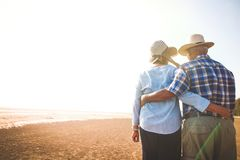 Free Elderly Lovers Hug Together At The Beach Stock Photos - 153770313