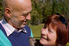 Elderly loving couple. Smiling elderly couple looking at each other Royalty Free Stock Photography
