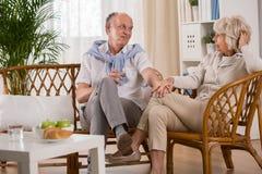 Elderly loving couple holding hands Royalty Free Stock Photos