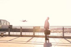 Elderly male businessman was late for the flight, the plane flew away, the concept of disrupting the deal due to late stock photo