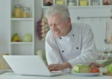 Elderly male chef Stock Image