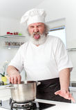 Elderly male chef in kithen Stock Photography