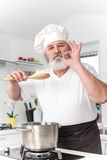 Elderly male chef in kithen Royalty Free Stock Images
