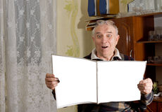 Elderly male pensioner reading a newspaper Royalty Free Stock Images