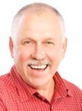 Elderly man. Smiling happy elderly man. Isolated over white background Stock Photos