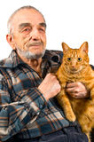 Elderly man. The elderly man with a cat stock photos