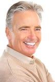 Elderly man. Smiling happy elderly man. Isolated over white background Royalty Free Stock Images
