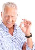 Elderly man. Smiling happy elderly man. Isolated over white background royalty free stock image