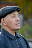 Elderly man. Portrait of the elderly man in a cap against the nature Stock Photo