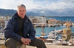 Elderly man against the port of Kyrenia Stock Image