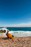 Elderly man at the beach Stock Image