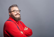 An elderly man with a beard in a red sweater. And glasses Stock Images
