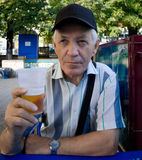 Elderly man with beer Stock Photo