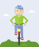 Elderly man on a bicycle Royalty Free Stock Photography