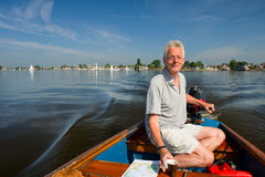 Elderly man in boat Royalty Free Stock Photography