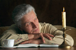 Elderly man with book. Portrait of elderly  man with book and coffee Royalty Free Stock Photo