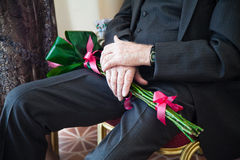 Elderly man with bouquet Royalty Free Stock Images