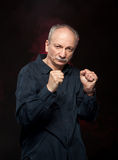 Elderly man in boxer pose Royalty Free Stock Images