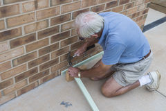 Elderly Man Building Framework. Stock Image