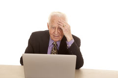 Elderly man business computer hand on head Stock Photos