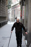 Elderly man with  cane, near Hairdressers Stock Photo