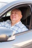 Elderly man  in   car. Stock Photography