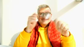 Elderly man of caucasian nationality, in bright clothes, fool around. Elderly man of caucasian nationality, in bright clothes, fool around, playing with a fork stock video