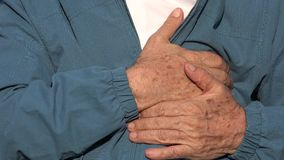 Elderly Man Chest Pains. Stock video in 4k or HD resolution stock video footage