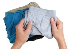 An elderly man chooses his clean panties to meet a new woman. Concept. Isolated top view studio shot Stock Images