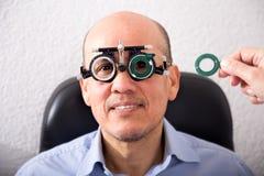 Elderly man client checks sight Stock Photo