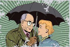 Elderly man closes the girl from the rain umbrella. Stock Photography