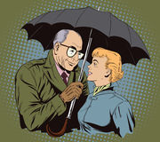 Elderly man closes the girl from the rain umbrella. Royalty Free Stock Photos