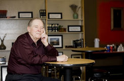 Elderly man in coffee shop royalty free stock images