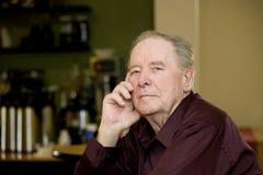 Elderly man in coffee shop royalty free stock image