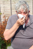 Elderly man with a cold. Royalty Free Stock Image