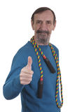 Elderly man with colorful skipping rope Stock Photos