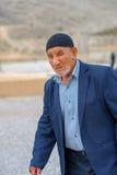 Elderly man comes back home. Persepolis, Iran, April 13, 2016 - the elderly man comes back home after the excursion according to the Persepolis Royalty Free Stock Photo