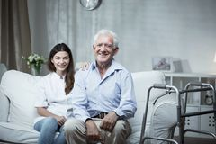 Elderly man with a community nurse. Elderly men with a community nurse visiting him Stock Photography