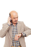 Elderly man complained looking at his watch, trying to call on t Stock Photos