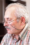Elderly man concetrating Royalty Free Stock Images