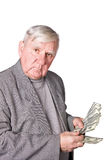 Elderly man considers money Stock Photo