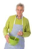 Elderly man cooking Royalty Free Stock Photo