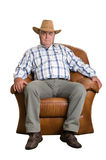 An elderly man in cowboy hat sitting in the chair Stock Photo