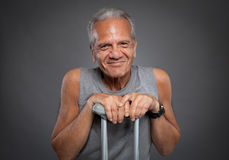 Elderly man with crutches Royalty Free Stock Photo