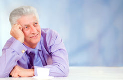 Elderly man with cup. Elderly man with a cup of tea Royalty Free Stock Photo