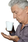 Elderly man with a cup Royalty Free Stock Photo
